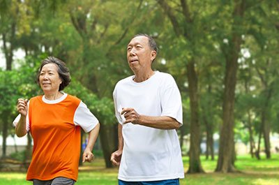 older couple running
