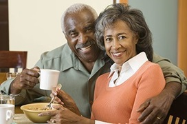smiling senior couple drinking coffee