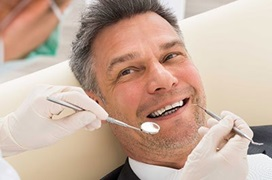 smiling man at dentist