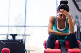 woman exercising with headache