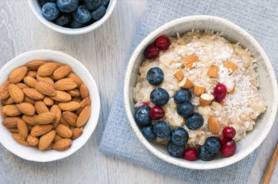 bowl of oatmeal with almonds
