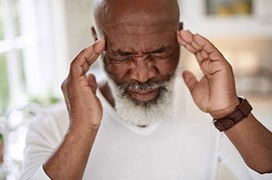 Man rubbing the sides of his head