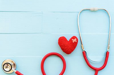 Red stethoscope with heart