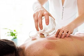 woman cupping patients back