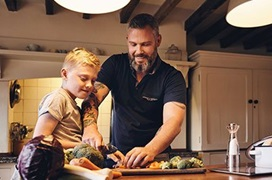 dad with son cooking