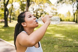 Athletic woman drinking too much water