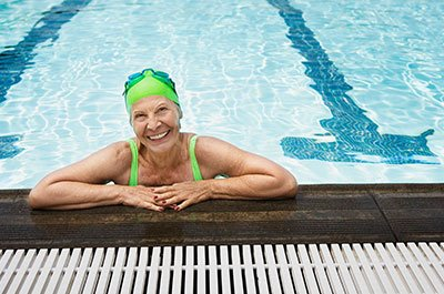 Woman swimming for a low impact workout