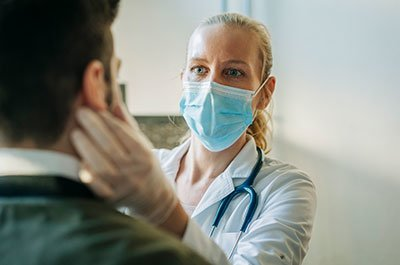 masked doctor with patient