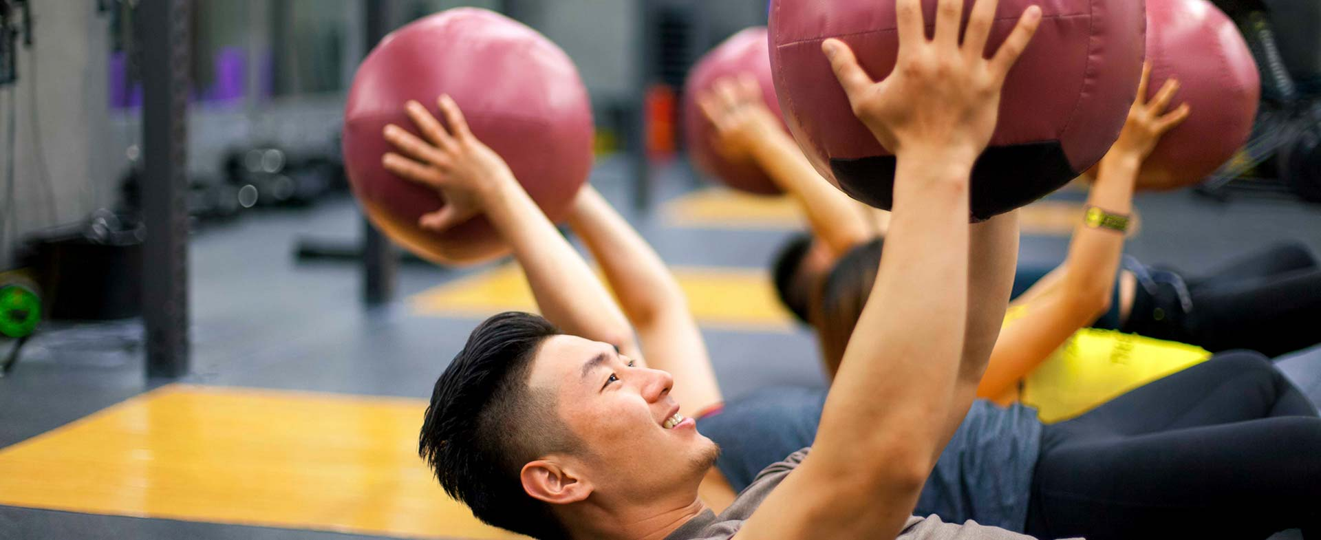 man using medicine ball
