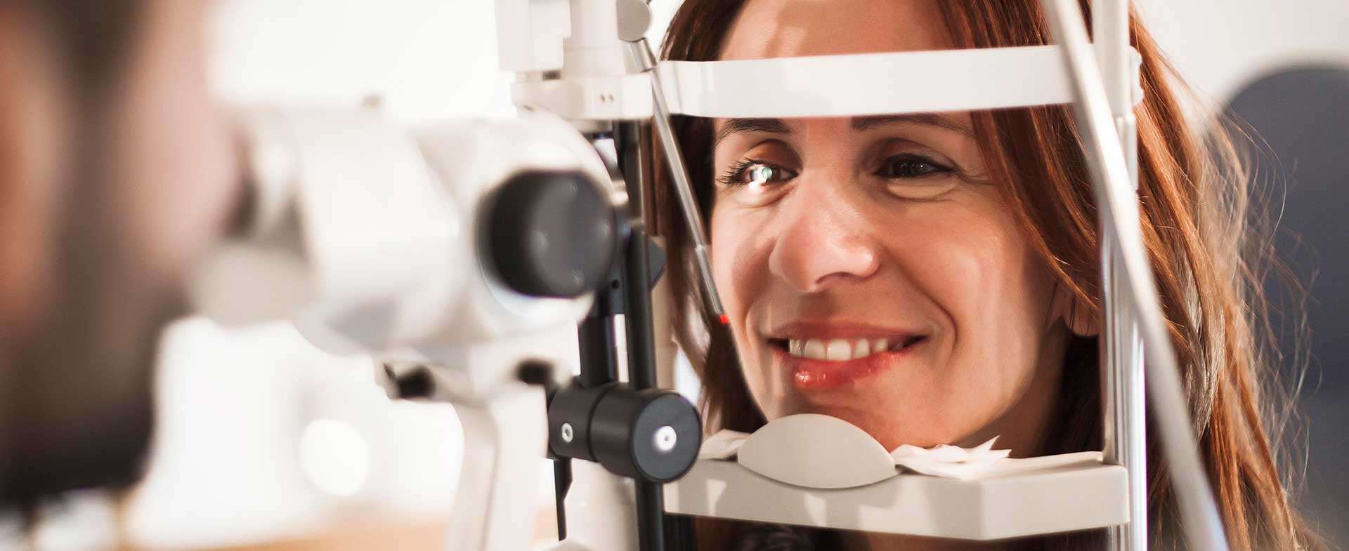 Woman over age 40 getting an eye exam