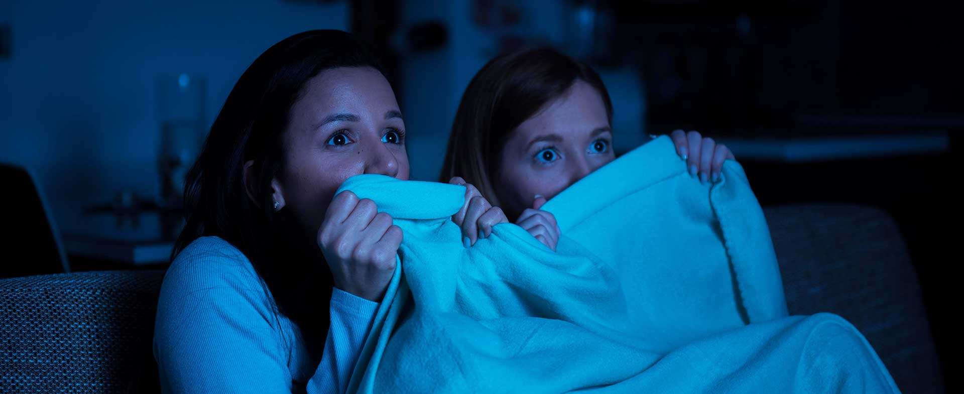 two women watching scary movie