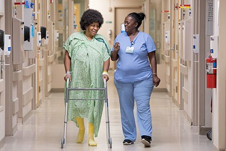 patient using walking assistant