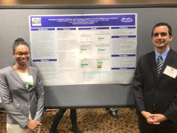 two residents at a conference with poster board