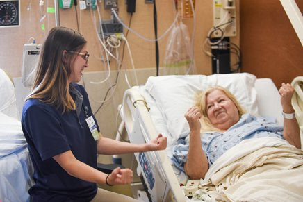 Henry Ford Hospital Macomb Volunteer with patient in bed
