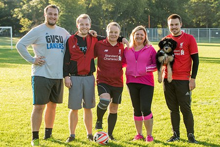 stroke patient mark on soccer field with family