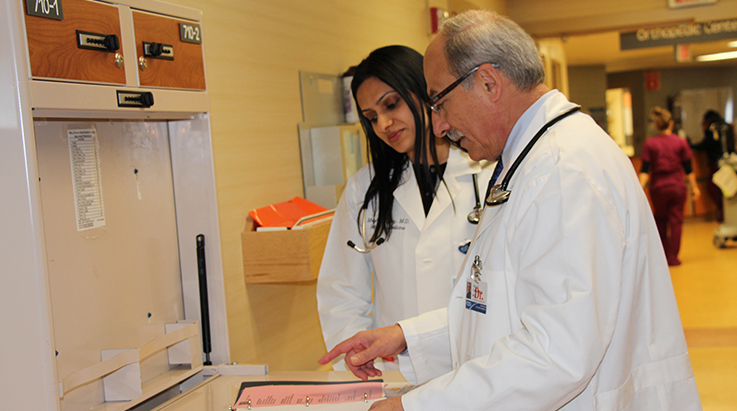 physicians reviewing documents