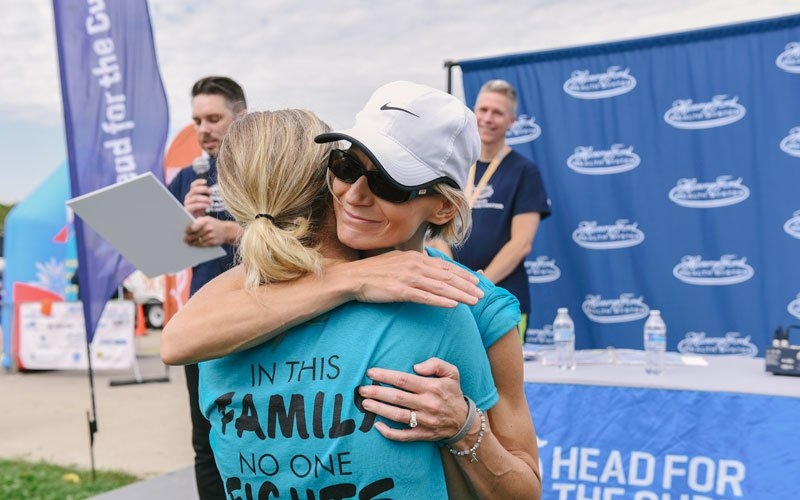 kate hugging friend at 5k