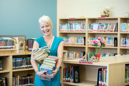 kate white in front of a bookshelf
