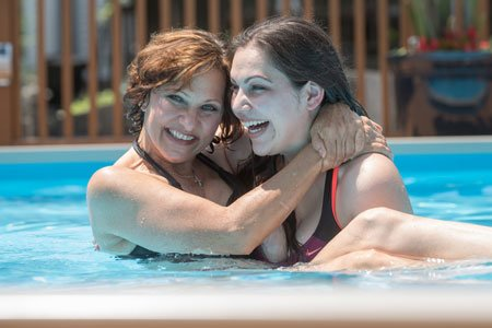 breast cancer patient lynn walkuski and her daughter in the swimming pool