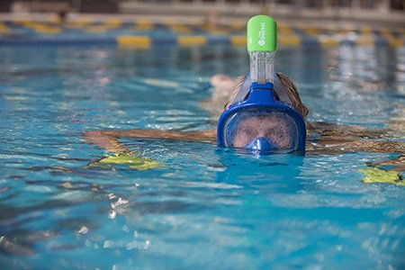 breast cancer patient mary nameth swimming with snorkel mask