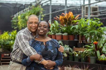 colon cancer patient donald robinson with wife zelda in greenhouse