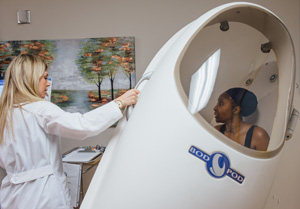doctor helping patient into Bod Pod
