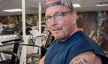 cardiology patient carl miller working out at the gym
