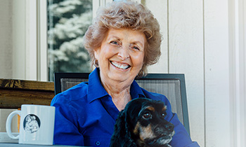 heart patient mary with her dog coco
