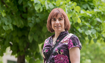 Heart patient Michelle Rachuk standing in front of trees