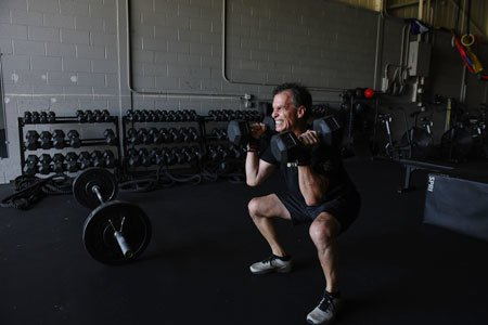 Knee replacement patient thomas rodgers lifting weights