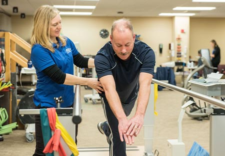 physical therapy  patient fred darga working with therapist kathy
