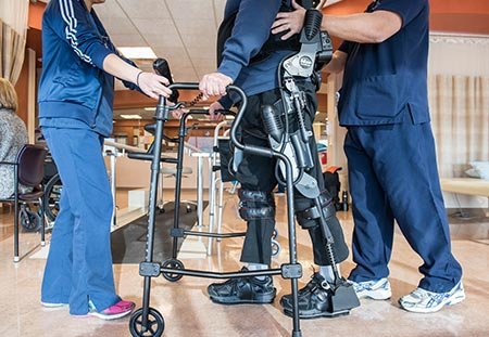 rehab patient jerome busam walking with exoskeleton