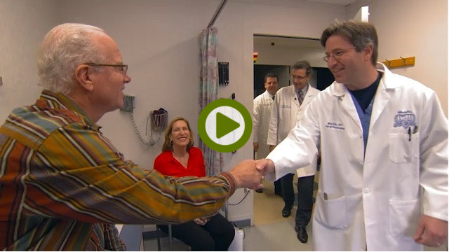 stroke patient shaking hands with doctor