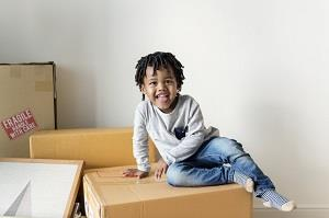 Boy on Moving Box