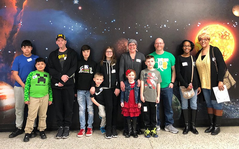 children with their parents at the planetarium
