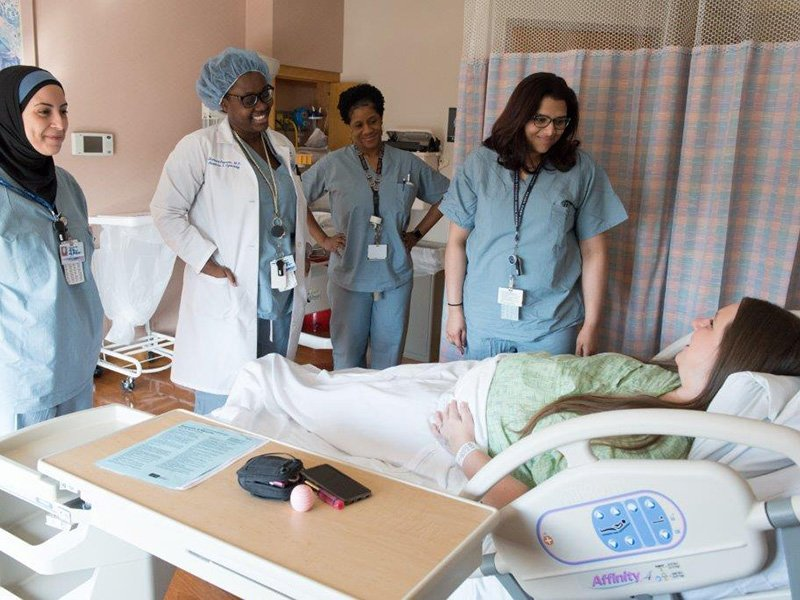 labor patient with caregiver team