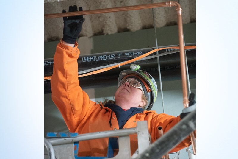 Female construction worker looking up